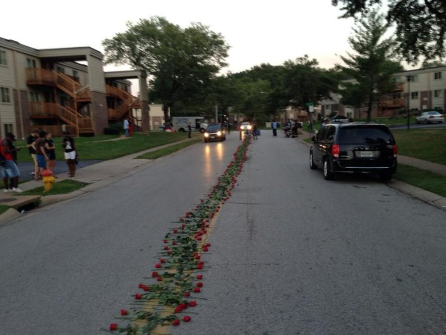 Protestors+lay+down+roses+on+the+street+where+Mike+Brown+was+shot